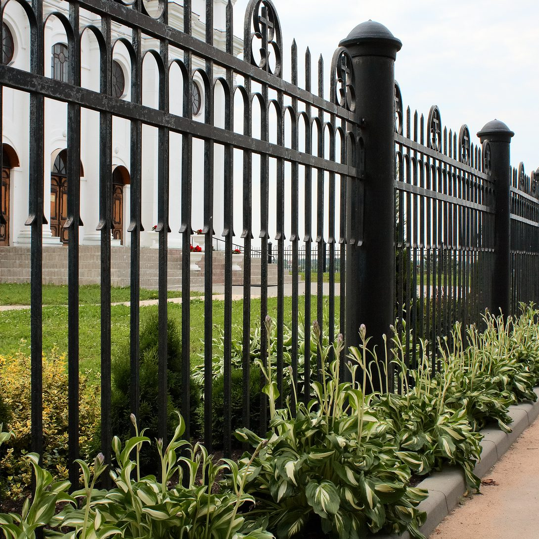 Wrought iron fence by the catholic church